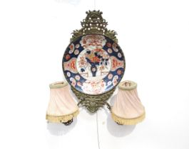 A pair of 19th Century double arm wall sconces created from Japanese Imari chargers mounted in
