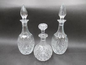 A pair of Brierley crystal diamond cut decanters with spier-shaped stoppers.