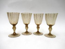 A set of four 19th Century smoky soda glass glasses,