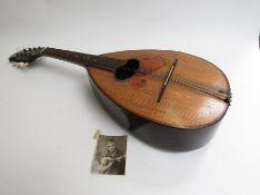 A mandolin of teardrop form