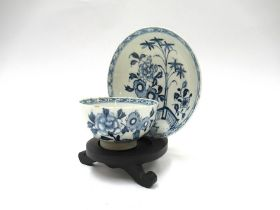 A Lowestoft porcelain blue and white tea bowl and saucer (see patt. on jug no.
