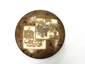 A late 19th Century Japanese Satsuma earthenware box and cover of shallow cushioned circular form,