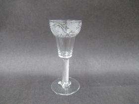 An 18th Century wine glass,