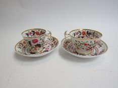 A pair of early 19th Century Spode cups and saucers with London hallmarks