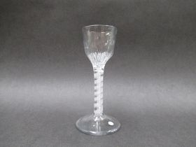A mid 18th Century wine glass with panel - moulded ogee bowl raised upon a double white cotton