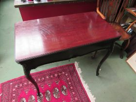 A circa 1900 mahogany games table,