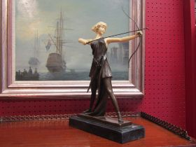 An Art Deco style bronze lady huntress on marble base,