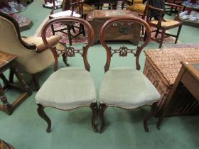 A pair of mid Victorian carved walnut chairs on cabriole fore legs