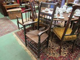 A circa 1820 North Country elm and oak rush seat elbow chair with turned decoration