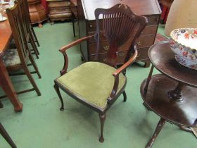 In the manner of Jas Shoolbred an Art Nouveau period mahogany elbow chair with pierced fan back