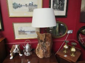 An unusual table lamp with a naturalistic tree form base,