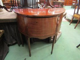 An Edwardian crossbanded mahogany bow front sideboard the single door with working key over spade