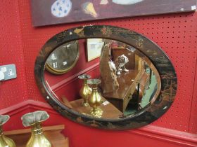 A Chinese oval bevelled edge mirror, with lacquered decoration (c.