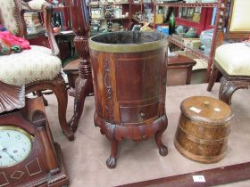 A Georgian round mahogany cellarette carved and string inlaid with draw, distressed,