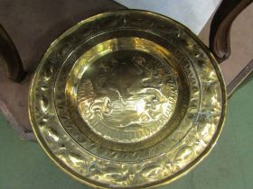 A circa 17th Century Nuremberg brass embossed Alms plate, a/f (repair to back),