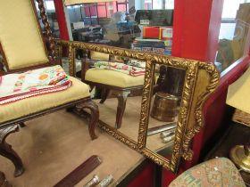 An ornate gilt frame tri-glass wall hanging mirror,
