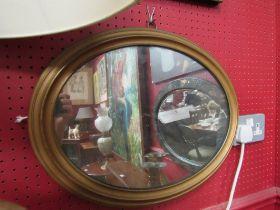 An oval wall mirror,