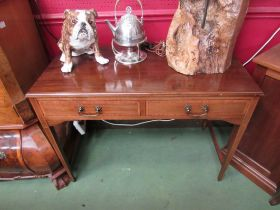 An Edwardian crossbanded mahogany side table the two frieze drawers over square tapering legs,