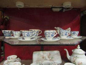 """A quantity of Johnson Bros Ironstone coffee wares """"Indies"""" pattern and willow pattern examples,"""