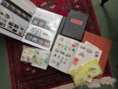 A quantity of first day cover albums, collectors' stamps,