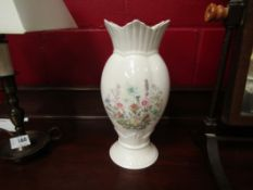 """A pair of Aynsley vases in the """"Wild Tudor"""" pattern,"""