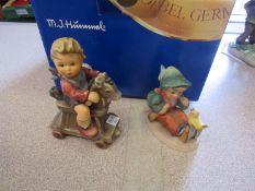 Two boxed Goebel figures,