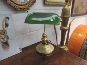 A brass based bankers lamp with green glass shade,