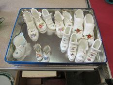 A collection of ceramic boots including Royal Albert, Coalport, Limoges,