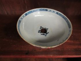 An 18th Century English Delft bowl with handpainted floral sprays, hole to base, for restoration,