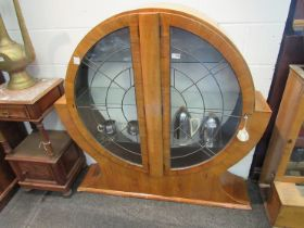 An Art Deco cabinet of rounded form,