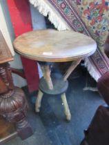 A circular top table supported by deer legs, 48cm diameter,