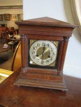 A mahogany mantel clock with Arabic dial,