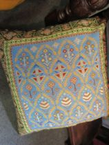 An oversized cushion, one side machine woven Eastern style design,