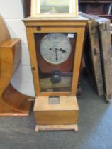 A clocking-in clock dial marked Egypt,