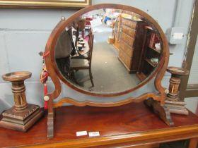 An Edwardian mahogany oval dressing table mirror