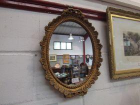 A gilt oval wall mirror,