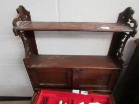 An Edwardian mahogany wall shelf with twin door cabinet,