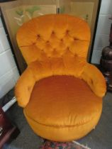 A button back chair on castors in mustard colour upholstery