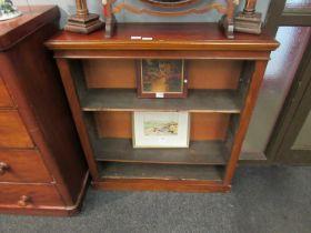 A Victorian mahogany three tier bookcase,