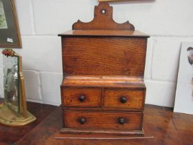 A 19th Century elm wall hanging cabinet, lift up flap and two drawers over single drawer,