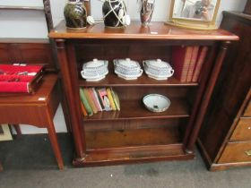 A Victorian mahogany and pine two shelf bookcase with column supports,