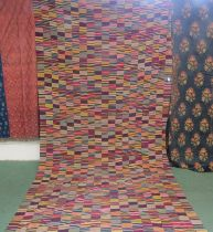 A possibly early 20th Century extremely large African Kente cloth hanging,