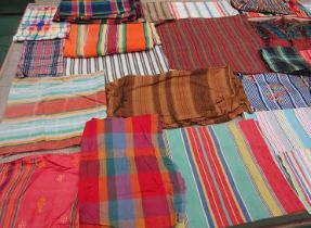 A considerable quantity of an assorted striped and checked collection to include shawls,