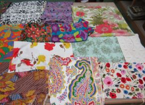 A good number of 1960's and 70's bright floral and psychedelic prints,