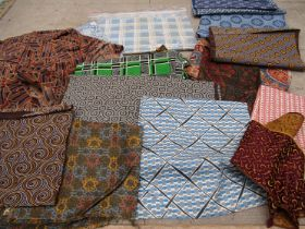 A small quantity of small scale swatches of geometric and African prints for men swear.