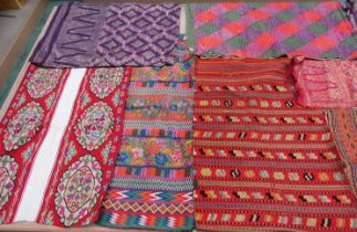 An impressive collection of ethnic embroideries and weavings to include Indian, Asian, Uzbek,