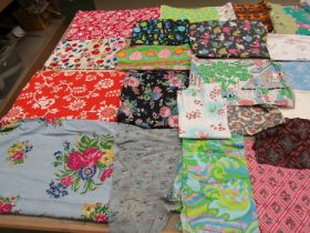 A suitcase containing a considerable quantity of dress and clothing prints,