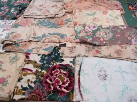 A quantity of 19th Century French and English cotton and chintz and mid 20th Century large scale