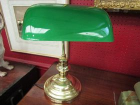 A green glass and brass bankers lamp