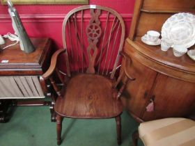 A pair of 19th Century wheel-back Windsor armchairs,
